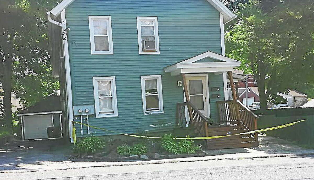 A house on Pearl Street was damaged Sunday morning after police said a drunken driver drove a van into it.