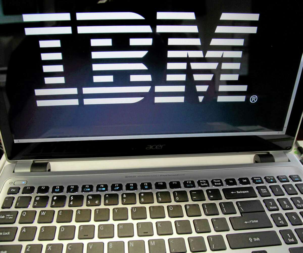 This July 16, 2013, photo shows an IBM logo in Berlin, Vt.