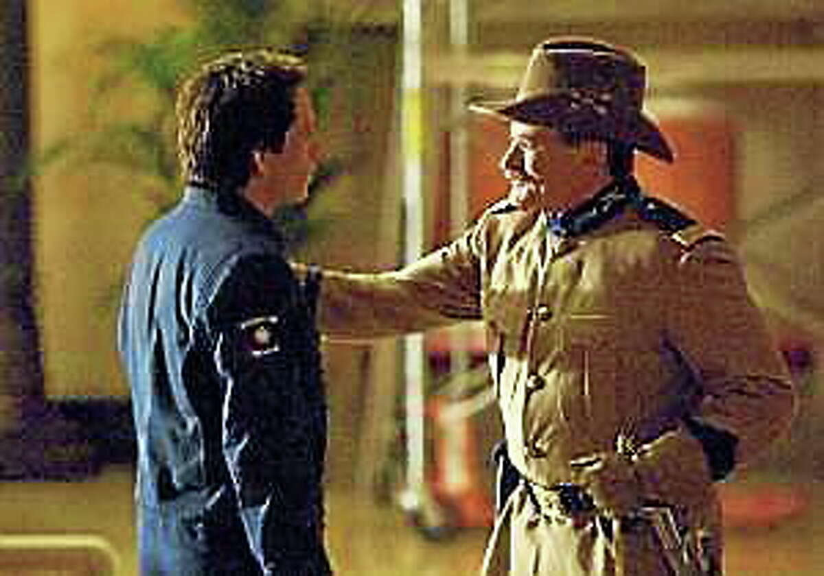"""In this film publicity image, Teddy Roosevelt, portrayed by Robin Williams, right, and Larry Daley, portrayed by Ben Stiller are shown in a scene from, """"Night at the Museum: Battle of the Smithsonian."""""""