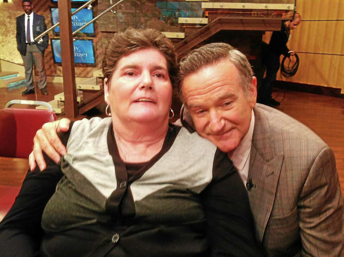 """Nancy Nicholoson, left, with Robin Williams at the """"LIVE Kelly and Michael"""" show in New York."""