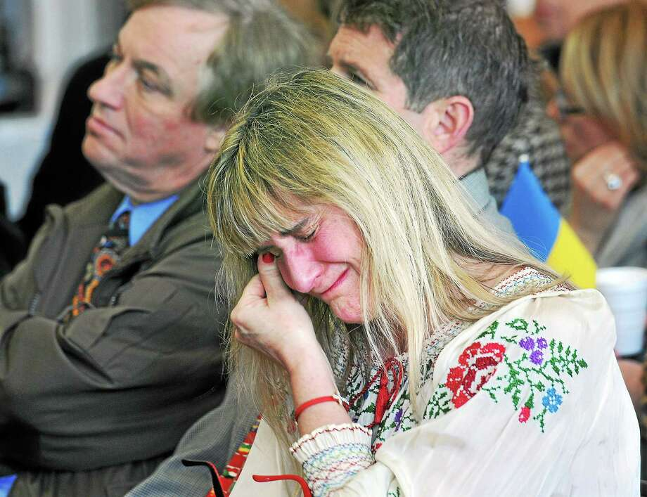 (Peter Casolino-New Haven Register)   Hope Langer-Marshall of Plainville cries during a memorial service at St. Michaels Ukrainian Church (New Haven) for those killed in the Ukraine during the past weeks.  pcasolino@NewHavenRegister Photo: Journal Register Co.