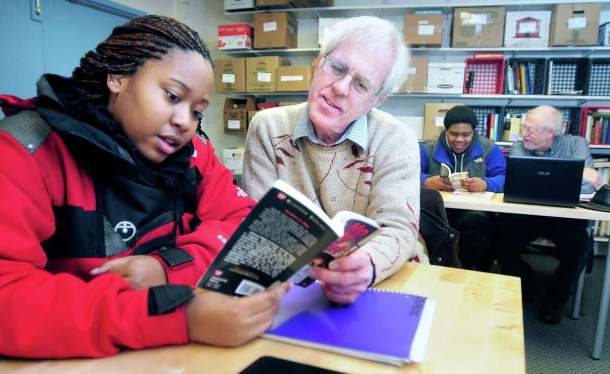 Cassandra Dubose (left), 14, of New Haven reads with Gregory Feeley of Hamden at New Haven Reads on 2/11/2014.