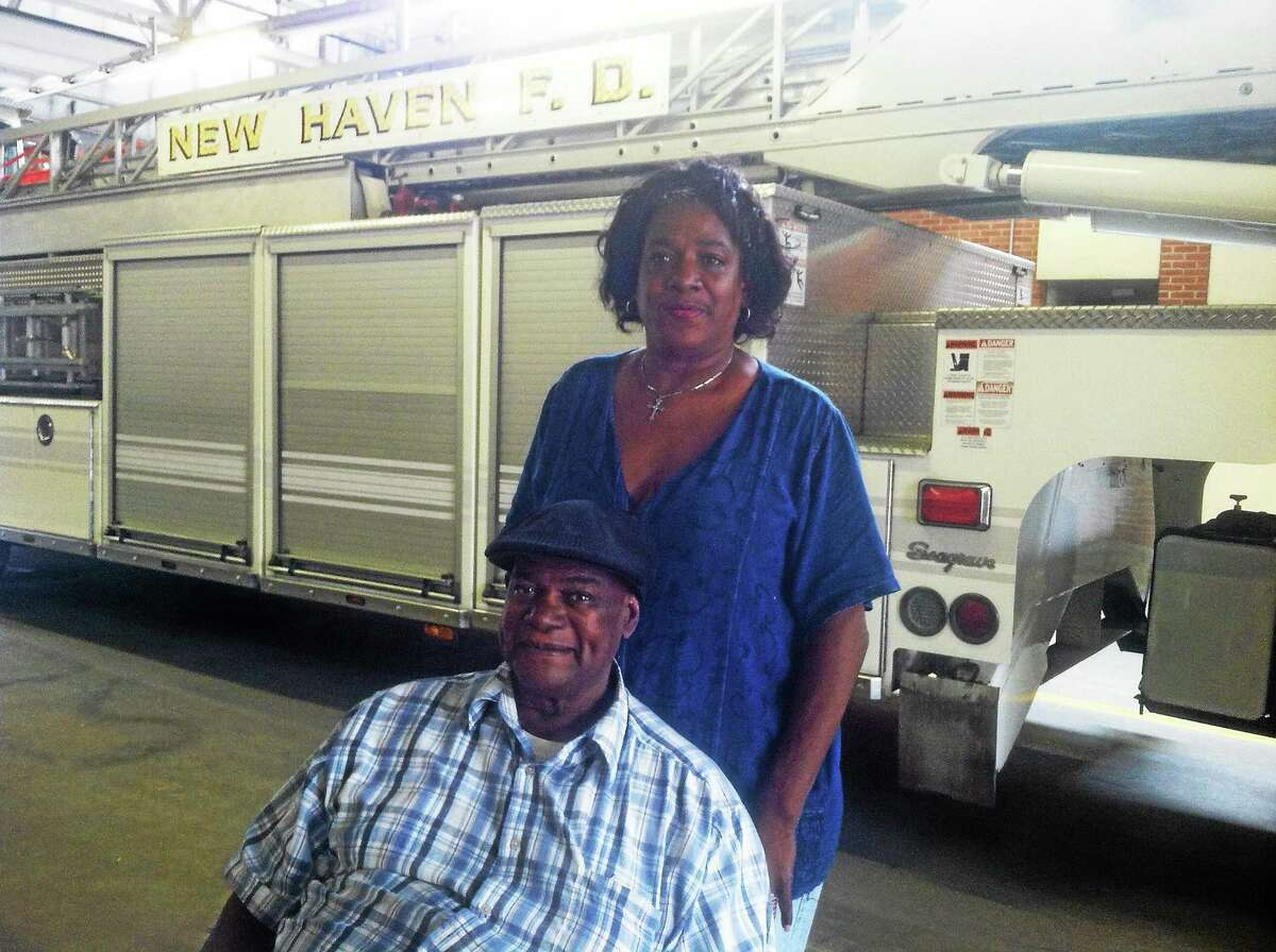 """Valerie """"Angel"""" Adams and David McClure, poll workers at the the Ward 5 polling place at the firehouse on Howard Avenue in New Haven, weren't busy at all Tuesday."""