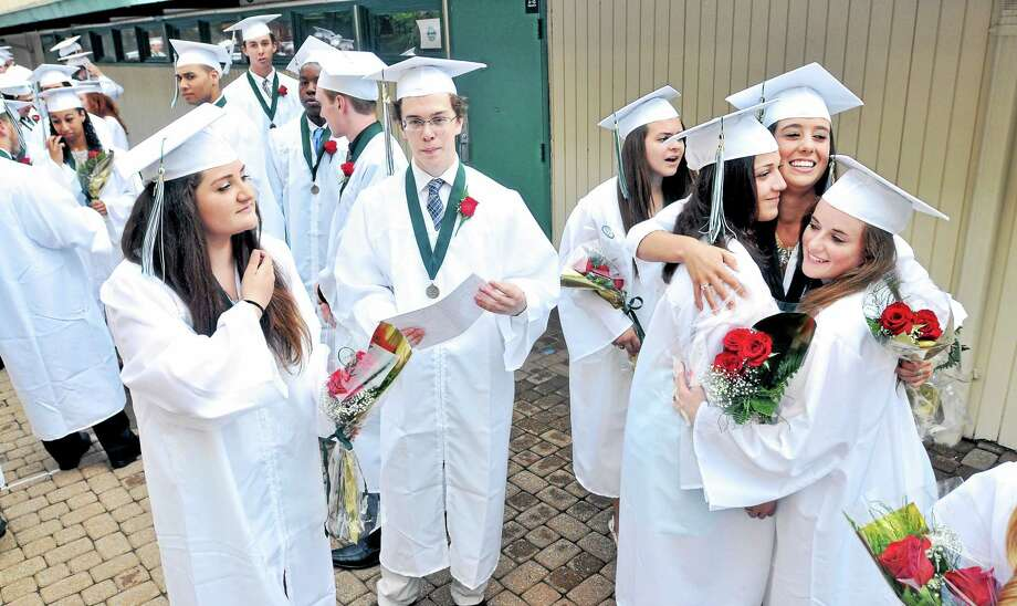 (Arnold Gold-New Haven Register)  (Left to right at right) Kaila DeFrancesco, Claire Kramer, and Katie Daily hug while waiting for graduation ceremonies to begin at Hamden Hall Country Day School on 6/13/2014. Photo: Journal Register Co.