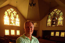 The former Westminster Presbyterian Church in downtown Beaumont is under renovation after it was recently purchased by the Riverside Church. David Young, Riverside pastor, stands in the Church's sanctuary on Tuesday. Young said he hopes to leave as much of the original structure as possible during renovations.  Photo taken Wednesday, July 20, 2017 Guiseppe Barranco/The Enterprise