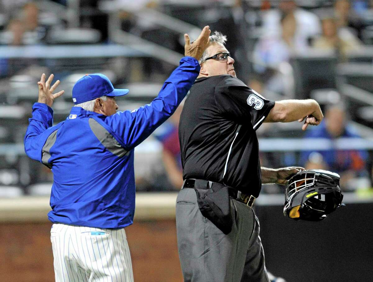 New York Mets manager Terry Collins, left, reacts as home plate umpire Gary Cederstrom, right, ejects him from during the fifth inning against the Milwaukee Brewers on Wednesday.