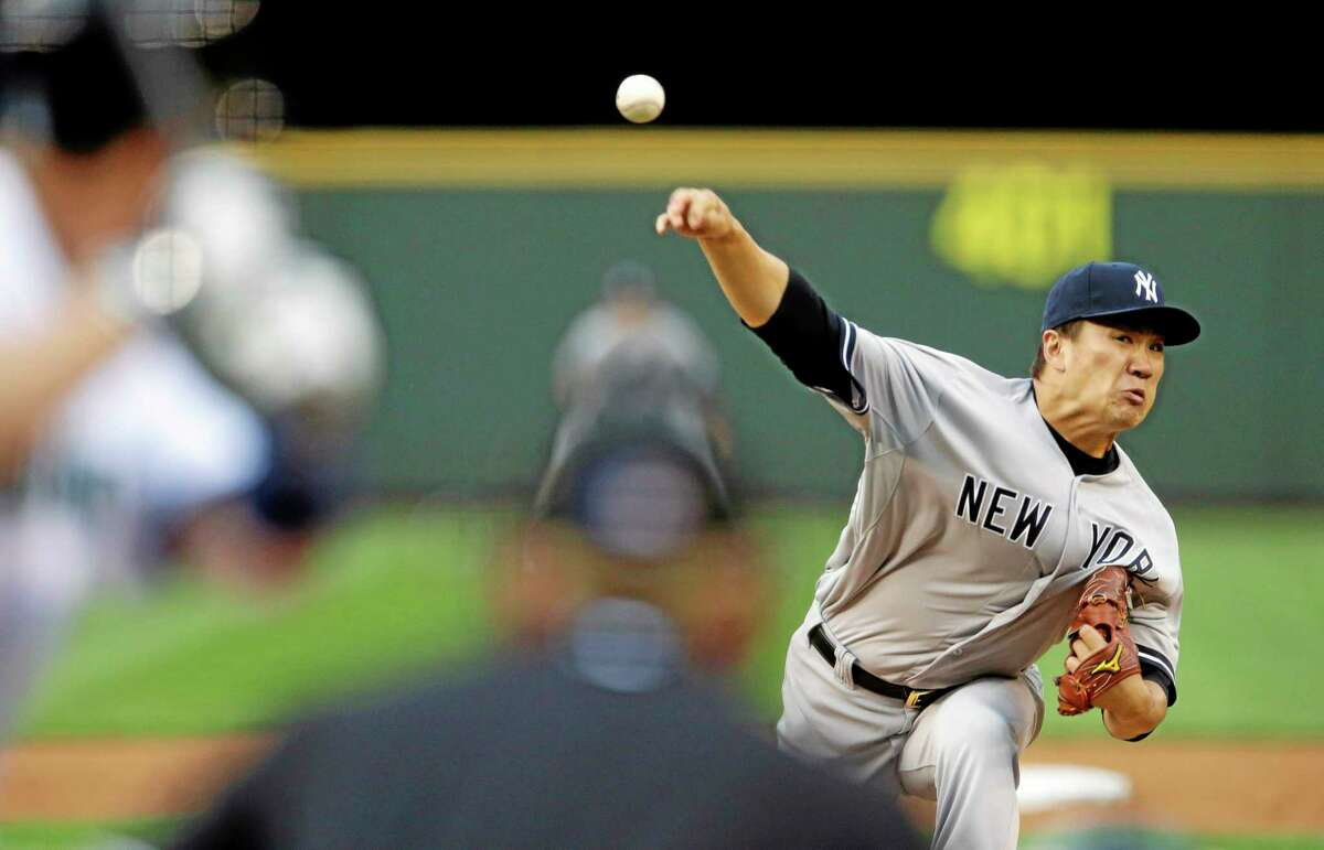 New York Yankees starting pitcher Masahiro Tanaka throws against the Seattle Mariners in the fourth inning Wednesday.