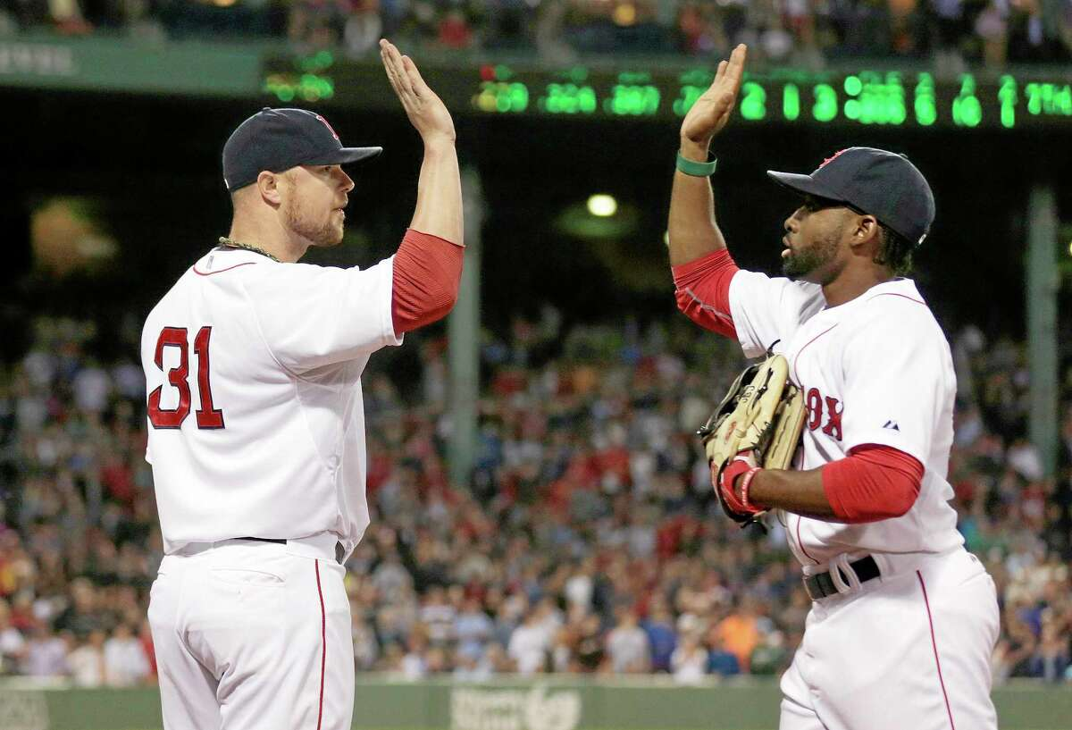 Red Sox starting pitcher Jon Lester, left, congratulates center fielder Jackie Bradley Jr. after the top of the seventh inning Thursday in Boston.
