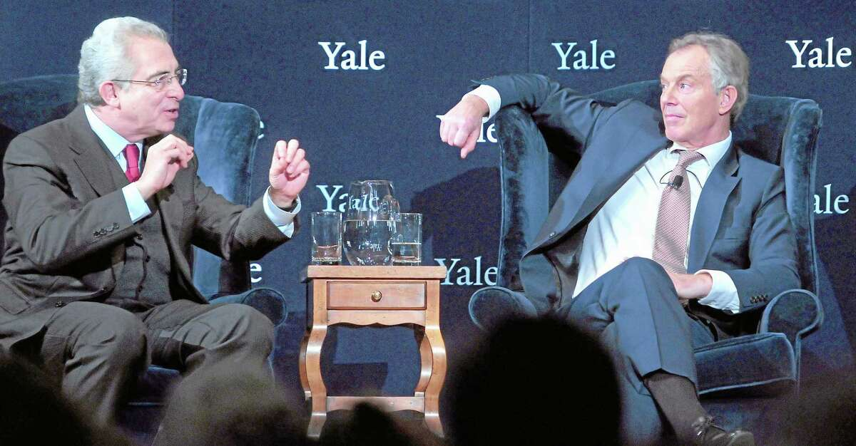 Former President of Mexico Ernesto Zedillo (left) and former British Prime Minister Tony Blair (right) participate in the forum, Global Crises: The Way Forward, at Yale University's Battell Chapel in New Haven on Dec. 3, 2012.
