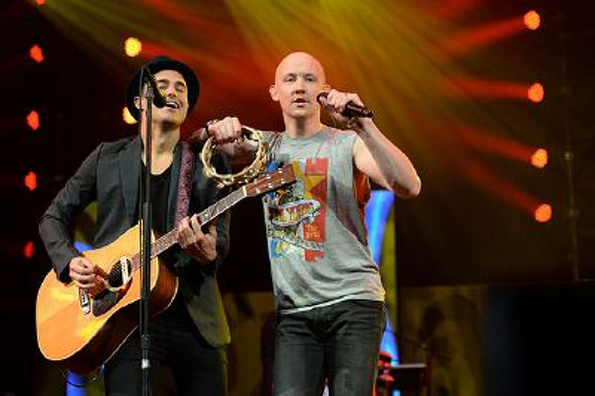 """Joe King (L) and Isaac Slade (R) of The Fray performs during Amnesty Internationals """"Bringing Human Rights Home"""" concert February 5, 2014 at the Barclays Center in the Brooklyn borough of New York. AFP PHOTO/Don EMMERT (Photo credit should read DON EMMERT/AFP/Getty Images)"""