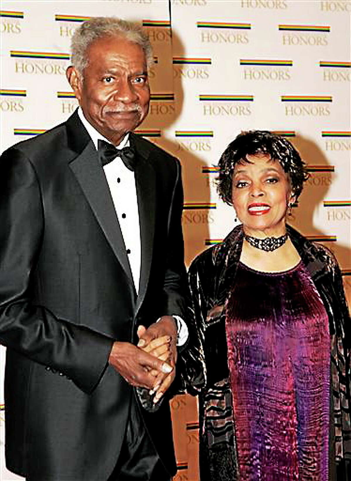In this Dec. 4, 2004, file photo, husband-and-wife actors, writers and producers Ossie Davis and Ruby Dee arrive at the State Department for a dinner celebrating them and the other Kennedy Center honorees, in Washington. Dee, an acclaimed actor and civil rights activist whose versatile career spanned stage, radio television and film, has died at age 91, according to her daughter. Nora Davis Day told The Associated Press on Thursday, June 11, 2014, that her mother died at home at New Rochelle, New York, on Wednesday night.