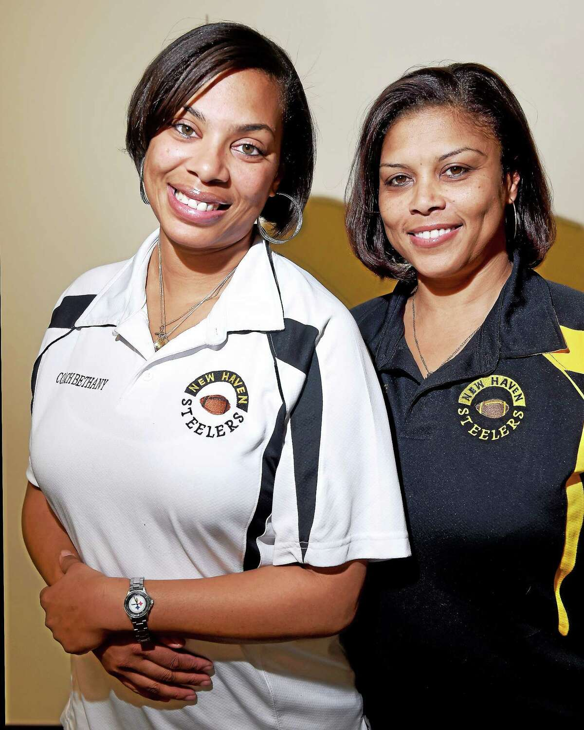 New Haven Steelers Pee Wee assistant coach Bethany S. Watkins (left) and team mom, Vera Esdaile, are photographed on 12/1/2014.