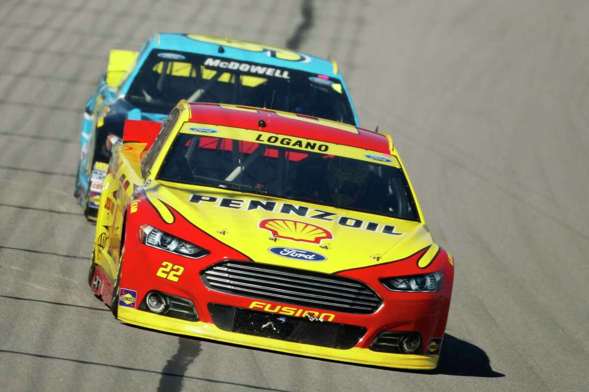 Joey Logano, front, and Michael McDowell head into turn one during Sunday's race at Kansas Speedway.