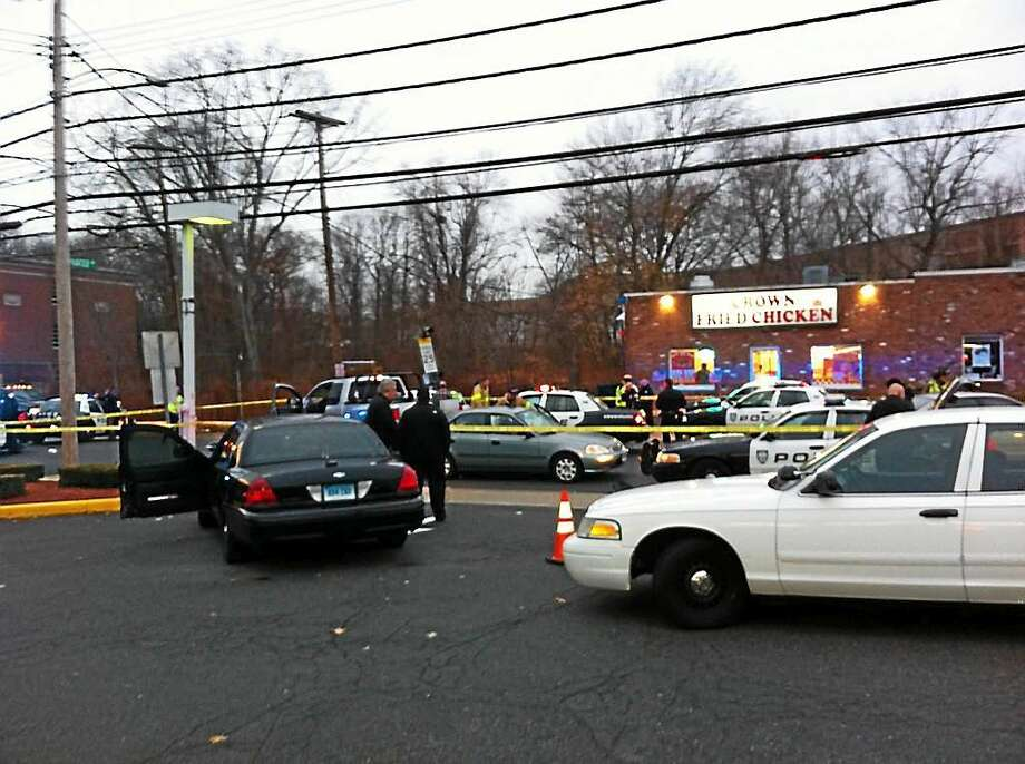Police at the scene of crash following a plice pursuit. Photo: Keldy Ortiz — New Haven Register