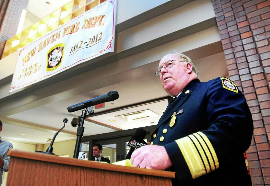 In this Oct. 11, 2012 file photo, New Haven Fire Department Chief Michael Grant speaks about the work of the department at City Hall in New Haven. Photo: Arnold Gold — New Haven Register
