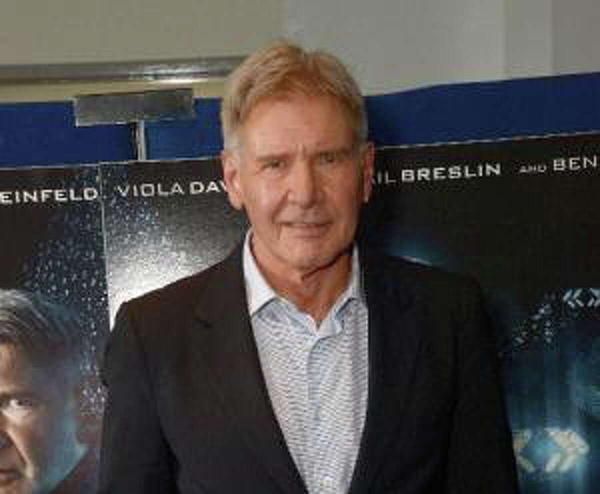 """In this Oct. 7, 2013, file photo, Harrison Ford poses for the """"Enders Game"""" photo call in London."""