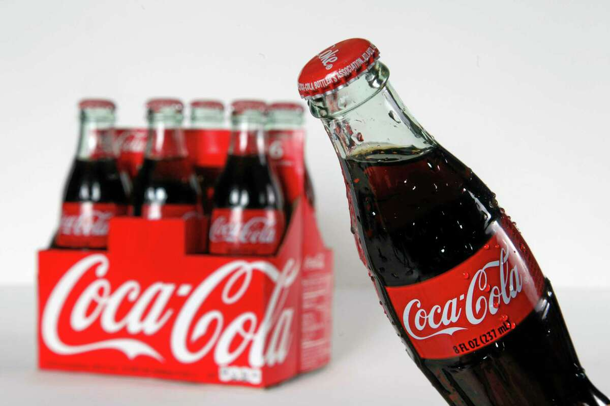 This Oct. 15, 2012, photo shows eight ounce bottles of Coca Cola arranged for a photo in Surfside, Fla. (AP Photo/Wilfredo Lee)