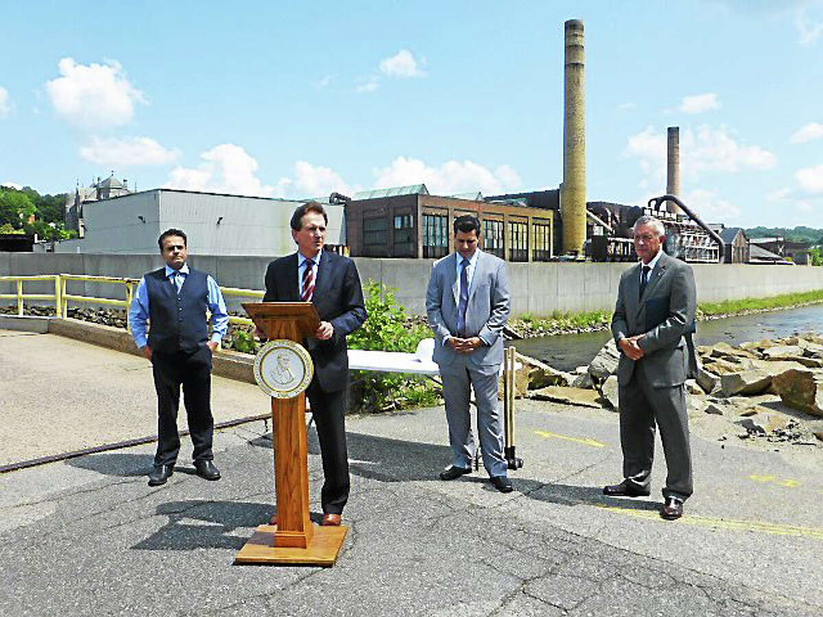From left, Ansonia Mayor David S. Cassetti; Gary OíConnor, an attorney for American Copper and Brass Co.; Ansonia Corporation Counsel John P. Marini, and Second Ward Alderman Phil Tripp at announcement of plans to demolish part of the former American Copper & Brass Co. factory that sits along the Naugatuck River.