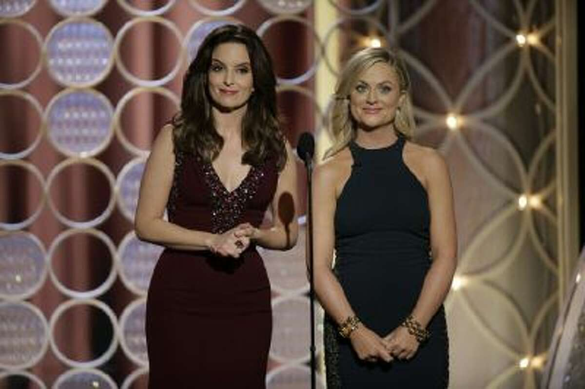 In this handout photo provided by NBCUniversal, Hosts Tina Fey and Amy Poehler speak onstage during the 71st Annual Golden Globe Award at The Beverly Hilton Hotel on January 12, 2014 in Beverly Hills, California.