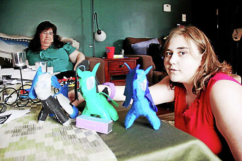 Kathleen Schassler photo  Wallingford seventh grader Rebekah Vincent displays the creatures she created by hand, as mom Kimberly Vincent looks on. Photo: Journal Register Co. / Kathleen Schassler All Rights
