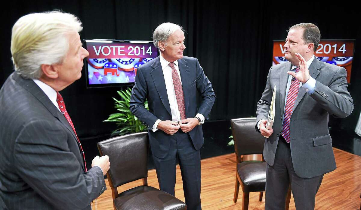 From left, Mark Davis of WTNH News 8, talks with Republican Gubernatorial candidates Tom Foley and John McKinney after the Connecticut Governor's Race, Republican Primary Forum at WTNH in New Haven Sunday.
