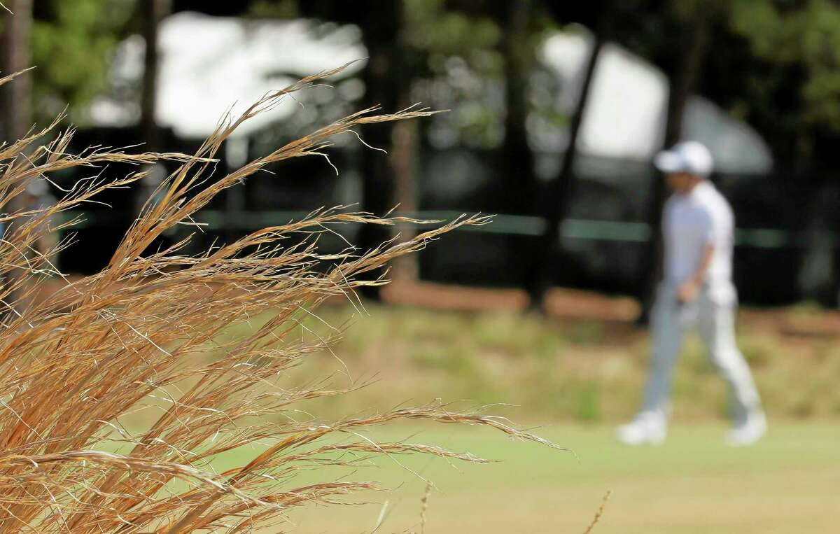 Adam Scott walks up the fairway on the 18th hole during a practice round for the U.S. Open Tuesday in Pinehurst, North Carolina.