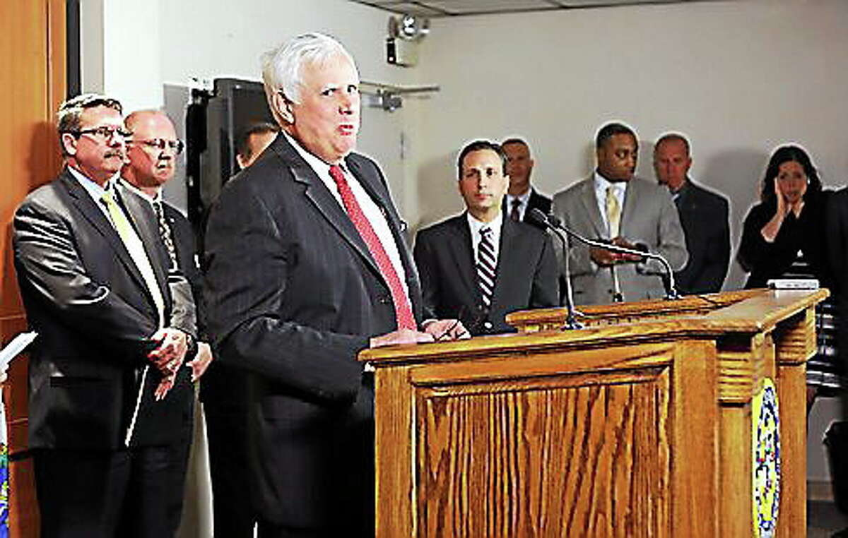Arthur House, chairman of the Public Utility Regulatory Authority, speaks at a press conference Monday.