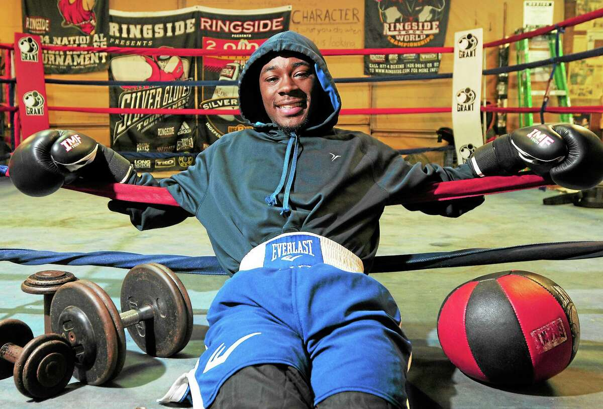 """New Haven boxer Tramaine """"Mighty Midget"""" Williams pleaded guilty Wednesday to possession of an assault weapon and possession of narcotics. He is scheduled to be sentenced on April 23."""