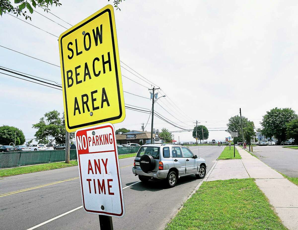 A car pulls into the town parking lot on Coe Ave. at Cosey Beach in East Haven on 7/8/2014.