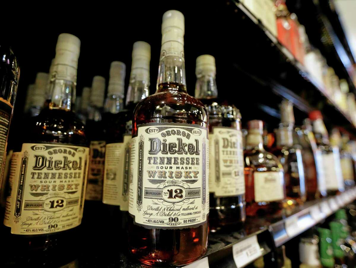 Bottles of George Dickel Tennessee whiskey are displayed in a liquor store Tuesday, June 10, 2014, in Nashville, Tenn. Alcohol regulators ended their investigation into whether George Dickel, a subsidiary of liquor giant Diageo, violated state laws by storing whiskey in neighboring Kentucky. (AP Photo/Mark Humphrey)