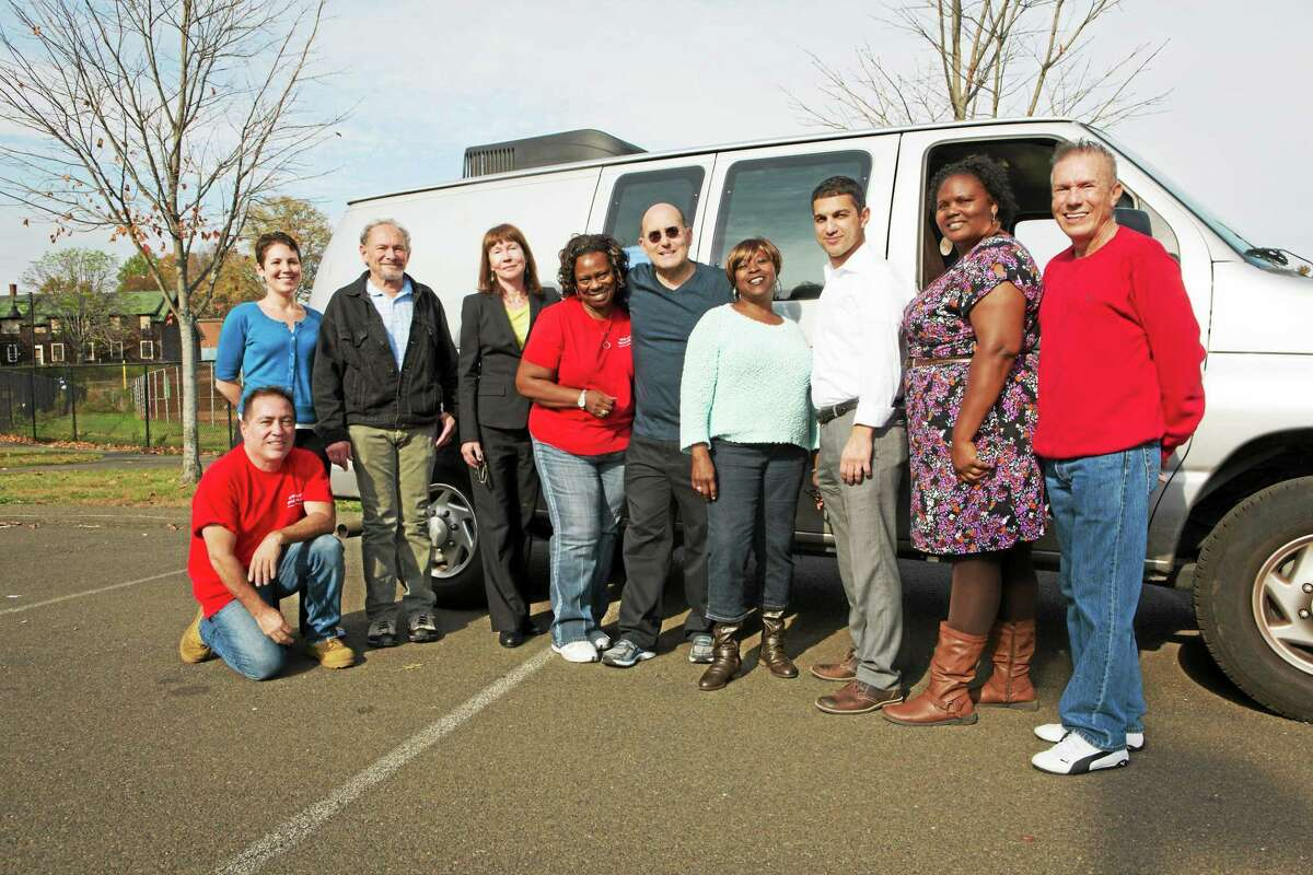Members of the New Haven Health Department's original needle-exchange program team pose with the program van during a recent reunion.