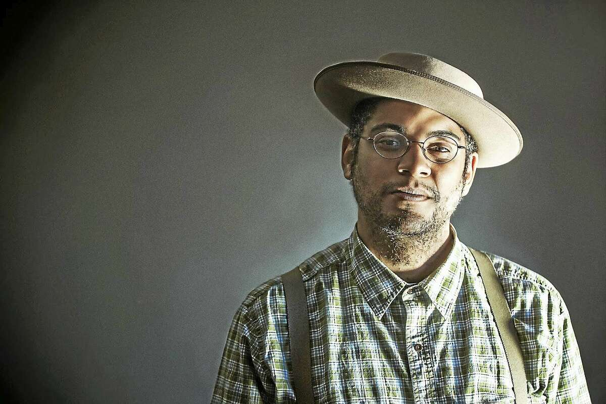 Dom Flemons says he incorporates his background in percussion in his banjo playing, which includes not only traditional clawhammer banjo, but also the tenor and three-finger styles of playing.