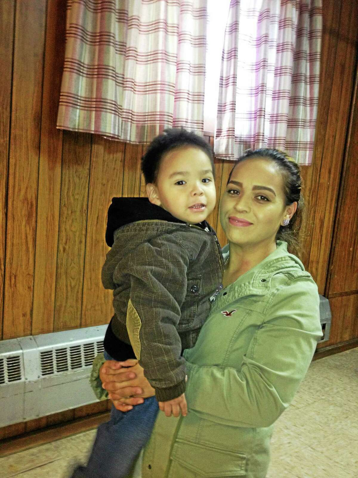 Araceli Ramirez took her son Alan, 5, to St. Rose of Lima Church to help undocumented immigrants apply for driver licenses.