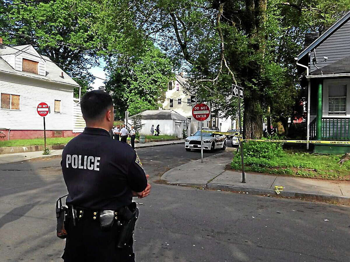 Police investigate a shooting on Frank Street in New Haven Wednesday.