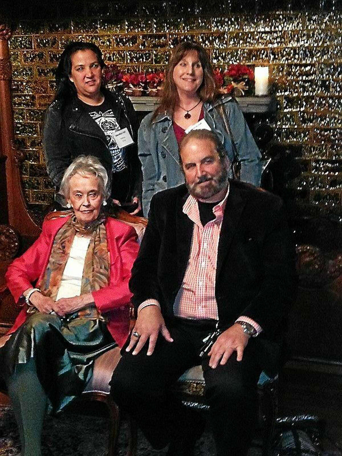 Front, from left to right, Paranormal investigator Lorraine Warren and her son-in-law Tony Spera meet fans at Lauralton Hall before there fascinating presentation to a sold-out audience. In the back, from left to right, Melissa Chop of Ansonia and Linda Ames of Milford are fascinated with the Warren's work.