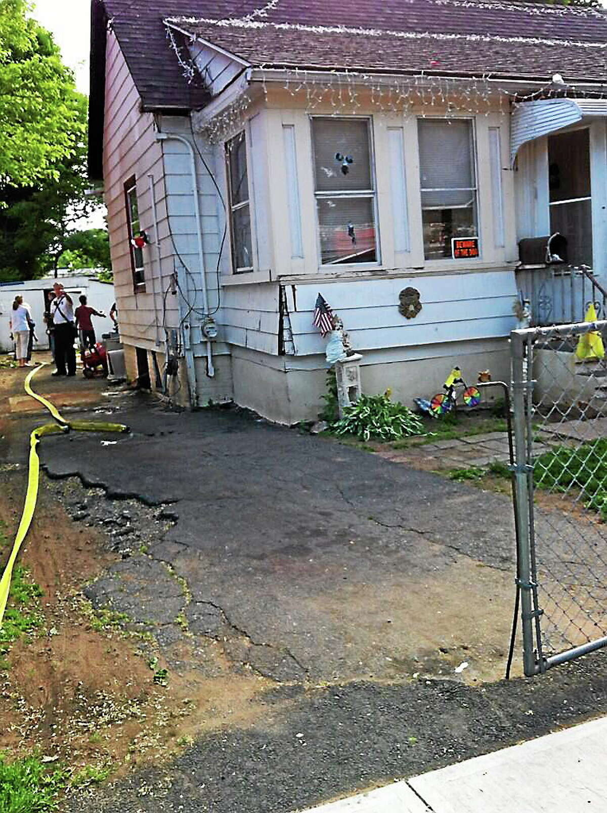 Firefighters at the scene of a basement fire on Front Street in West Haven.