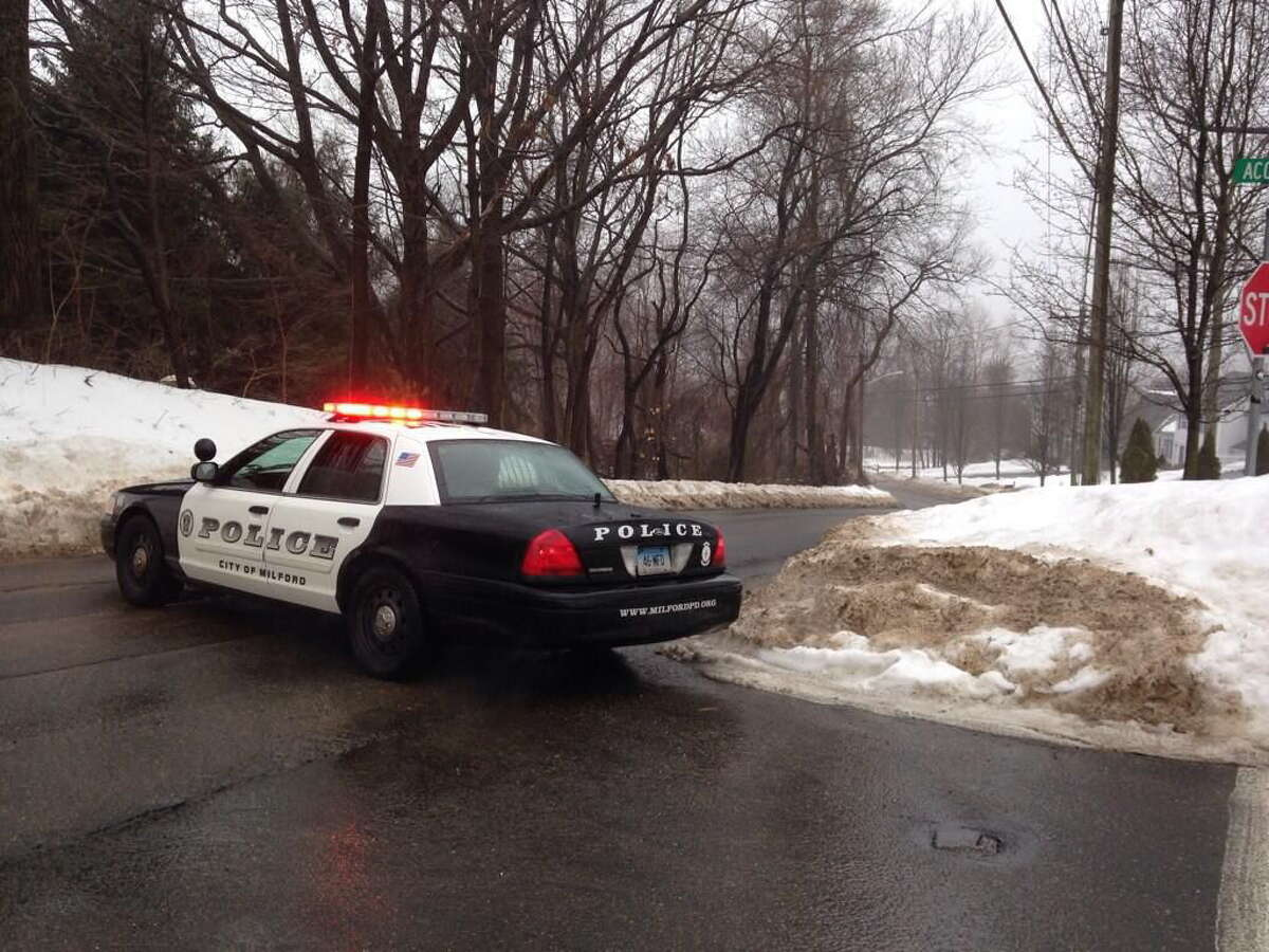 Milford police block off part of Oronoque Road after a train hit a car at a crossing Friday afternoon.