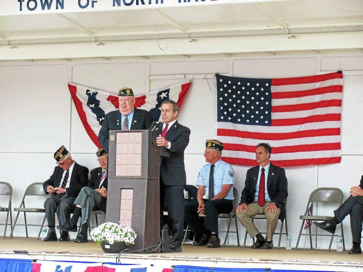 First Selectman Michael Freda, right, stands next to Daniel Riccio Jr. as he declares May 24 as Daniel Riccio Day.