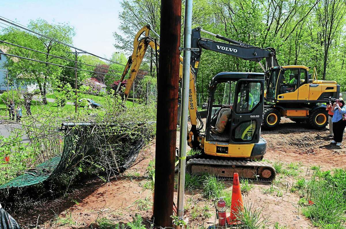A portion of the Hamden-New Haven fence being torn down, in this May 12 file photo.