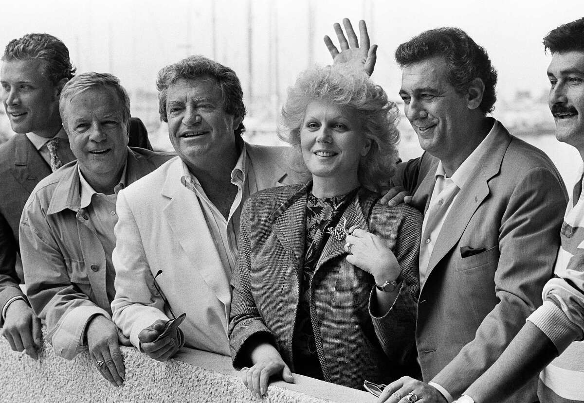 """FILE - In this May 15, 1986 file photo, from left, Italian film director Franco Zeffirelli, Israeli Producer Menahem Golan, opera singer Katia Ricciarelli and Mexican Singer Placido Domingo in Cannes, for the screening of their film """"Otello"""" in competition in the 39th Cannes film festival. Golan, a veteran Israeli filmmaker who produced some of the biggest action movies of the 1980s, has died in Tel Aviv. He was 85. (AP Photo/Michel Lipchitz, File)"""