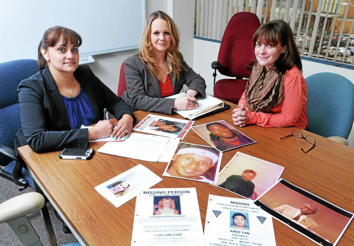 (Peter Casolino-New Haven Register) New Haven Police detectives Jessie Agosto, left, and Ann Mays, right, along with Sgt. Elisa Tuozzoli are working on old missing persons cases. Some of the cases date back to the early 1990; one dates to 1976.