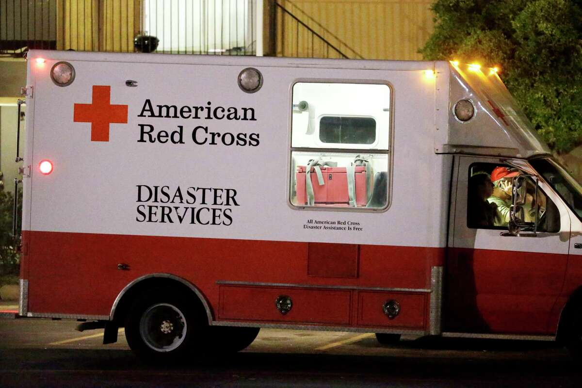 Red Cross representatives depart The Ivy Apartments after dropping off supplies to residents in one of the units at the complex, Thursday, Oct. 2, 2014, in Dallas. Dallas city officials asked a family who resides at the complex who had contact with a man diagnosed with the Ebola virus to remain in their home. (AP Photo/Tony Gutierrez)