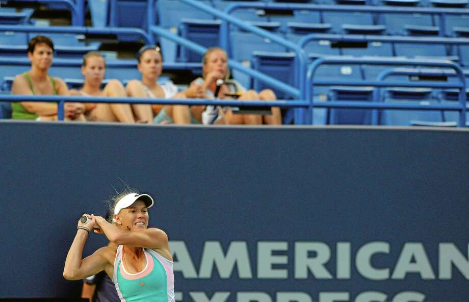 In this Aug. 22, 2013 file photo, Caroline Wozniacki follows through on a return shot during a match at the New Haven Open. Photo: Fred Beckham — The Associated Press File Photo   / FR153656 AP