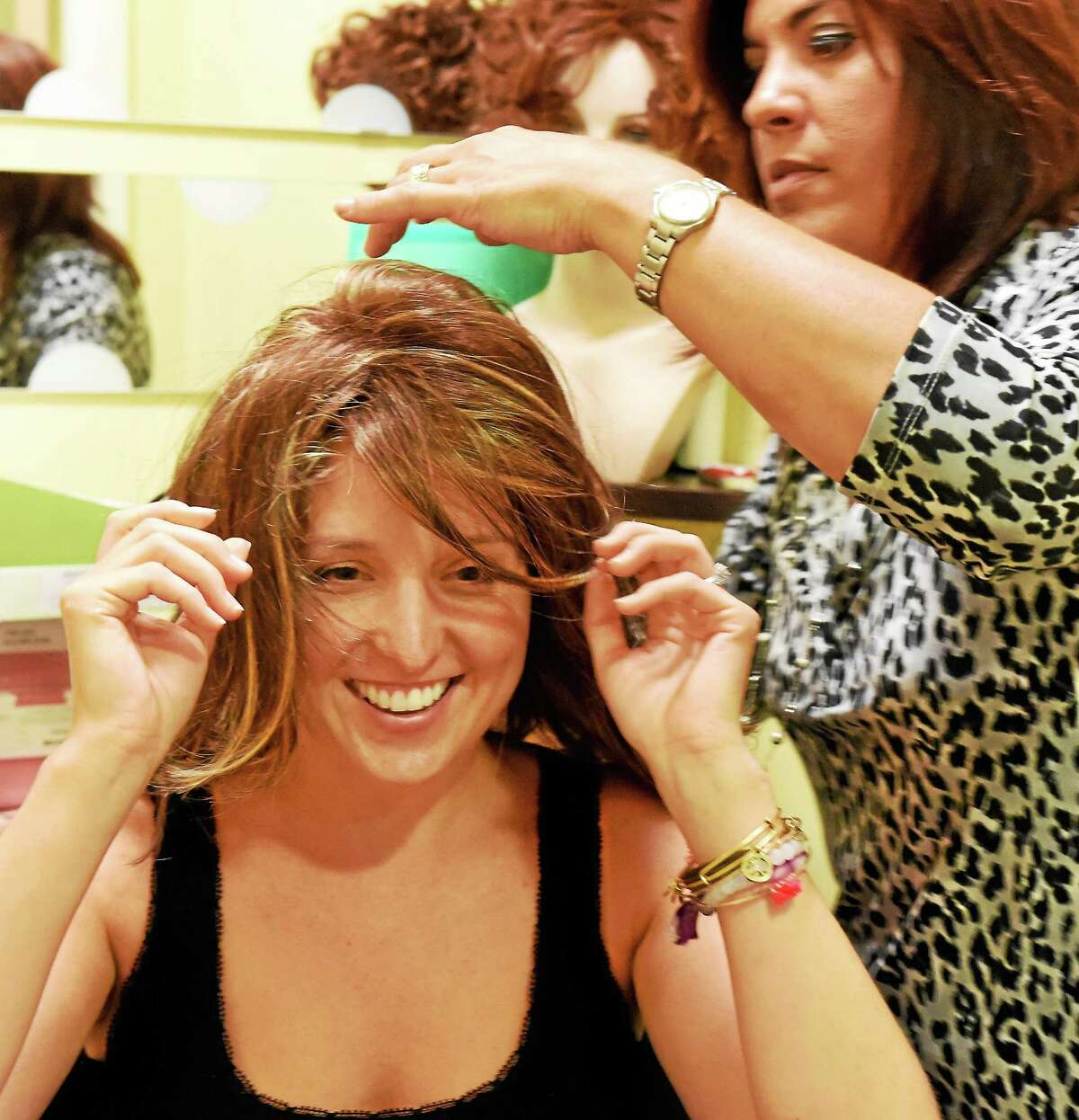 Andrea M. Torre of Wallingford, a licensed cosmetologist and certified wig specialist at the Smilow Cancer Hospital at Yale-New Haven in the Cingari Family Boutique, provides a wig consultation and fitting to cancer patient Ana Griffin of Fairfield, as she tried, and was fitted for, various styles of wigs by Torre Tuesday, August 5, 2014