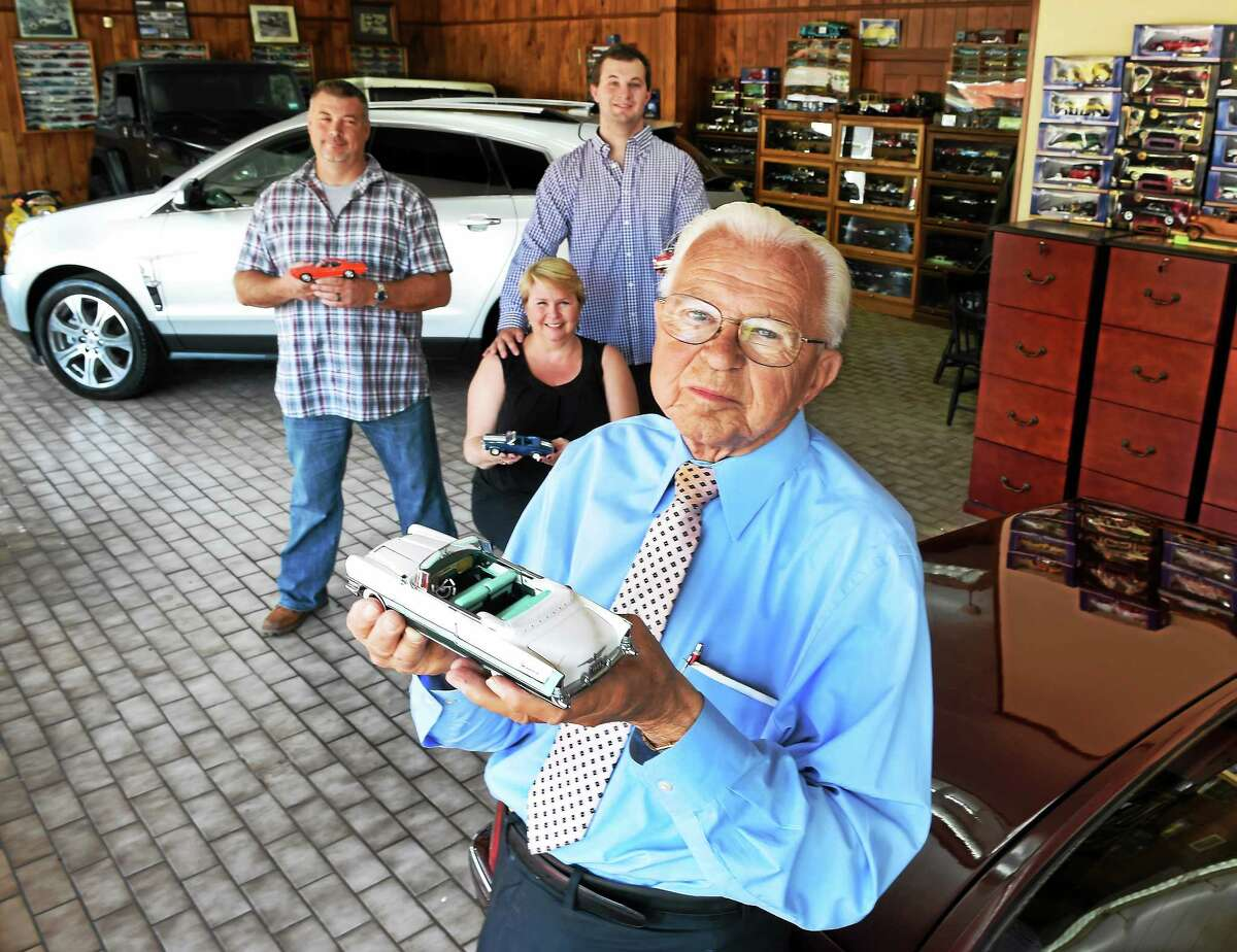 William Keating, 85, who co-founded Keating Bros. Motors, Inc. in Hamden in 1944, a family business, with his son William Keating, Jr., left, daughter Marybeth Keating, and grandson Nolan Keating Rich, in the showroom of their automotive sales and car repair business Tuesday, August 5, 2014.
