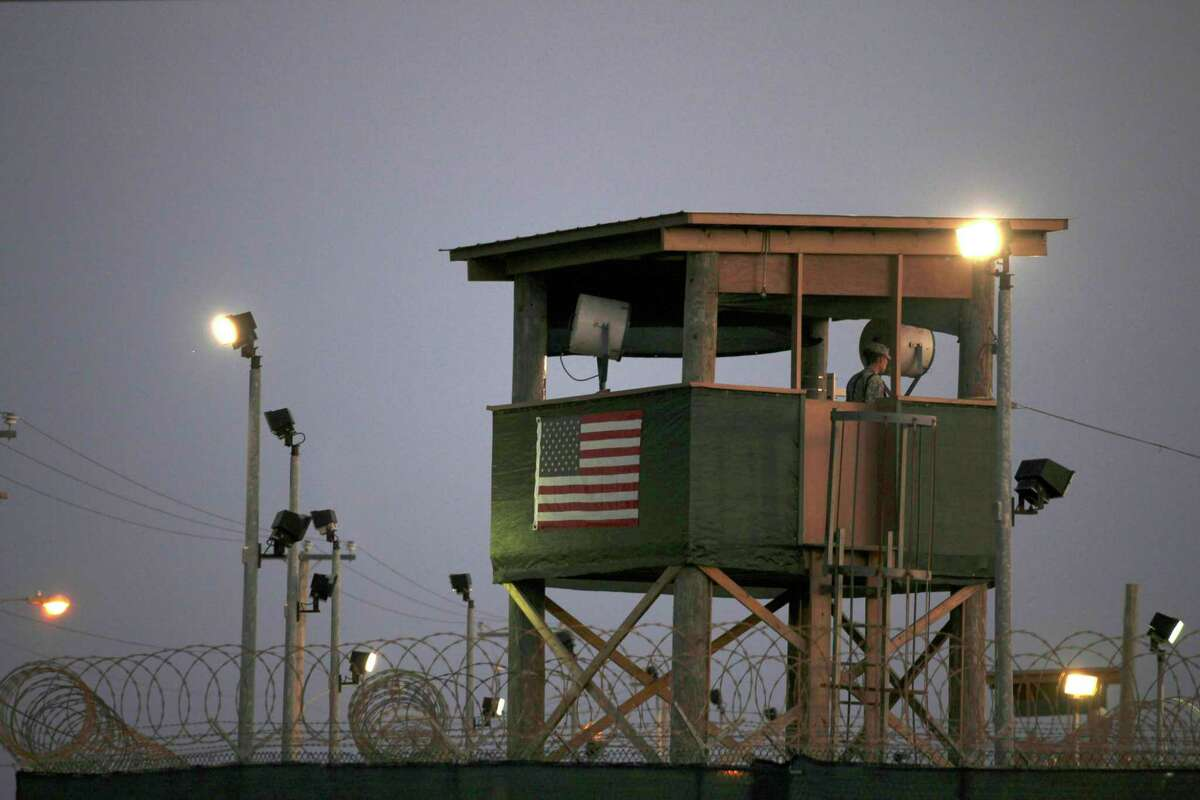 In this file photo of March 29, 2010 , a guard keeps watch from a tower on the Guantanamo Bay naval base, where suspected terrorists are prisoners . Half of Americans believe that there is a high risk of a terrorist attack in the United States.