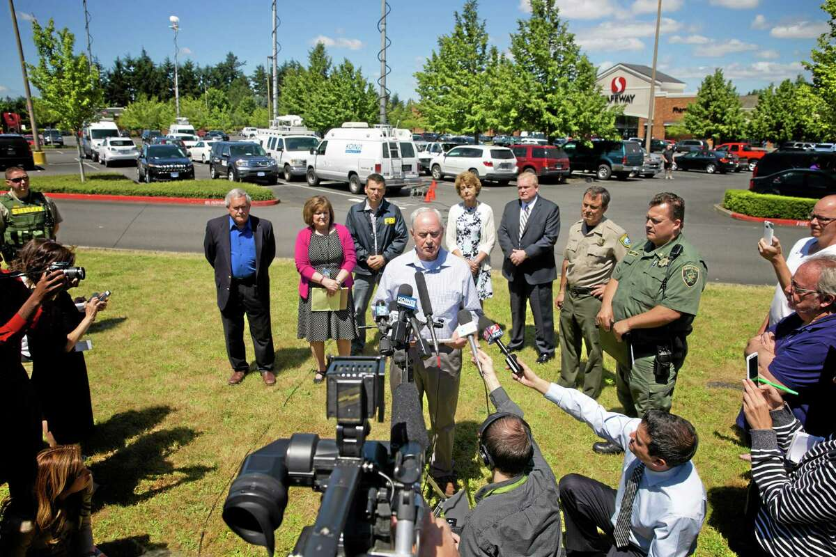 Troutdale Police Chief Scott Anderson speaks during a news conference in a Safeway parking lot near Reynolds High School on Tuesday, June 10, 2014, in Troutdale, Ore. A gunman killed a student at the high school east of Portland on Tuesday and the shooter is also dead, police said.