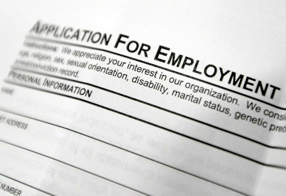 FILE - This April 22, 2014, file photo shows an employment application form on a table during a job fair at Columbia-Greene Community College in Hudson, N.Y.