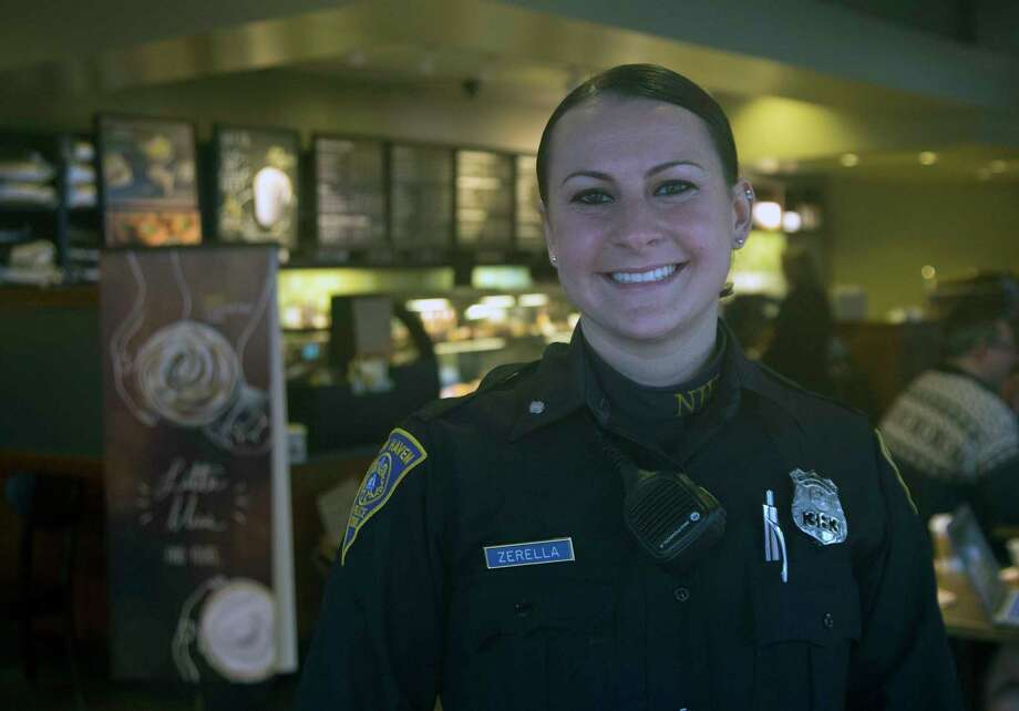 New Haven police Officer Caitlin Zerella's intuition led to the arrest of a man wanted in Puerto Rico for a double homicide. Photo: Rich Scinto — New Haven Register