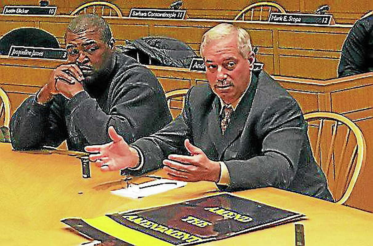 Fire union President Lt. James Kottage, right, sits next to Firebirds Society President Mike Neal at a 2013 Finance Committee meeting.